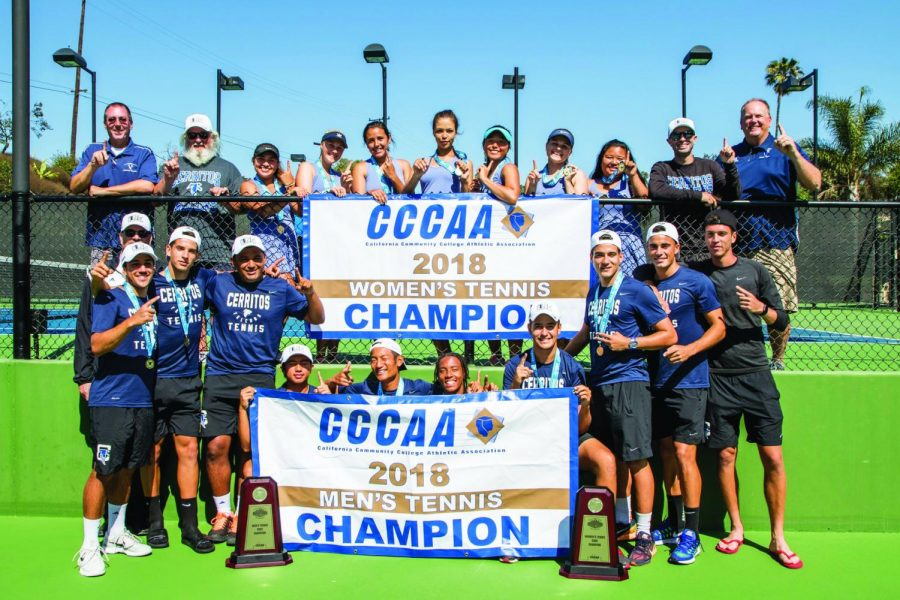 The men's and women's tennis teams hold up their respective championship banners. The men's team won their first ever Dual State Championship, while the women's team won their second title in the last three seasons.
