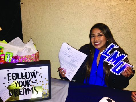 All-American soccer player, Itzel Ballesteros holds up her letter of intent to Lincoln Memorial University. The former Falcon will hang her cleats in Tennessee for two years.