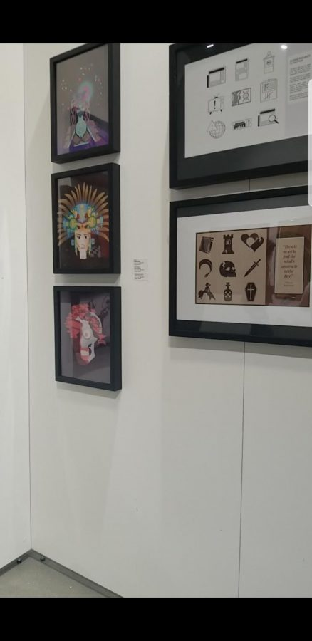The wall hosts student artwork that were picked for the exhibition. The event was held on April 26.