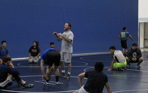 Head coach Don Garriott showing the team what technique to practice next. Garriott is training his team hard for better outcomes. Photo credit: Carlos Ruiz