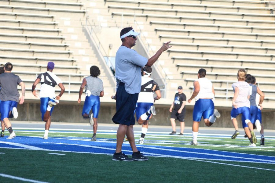 Head+coach+Dean+Grosfeld+during+football+practice.+Grosfeld+is+preparing+his+players+for+the+first+kickoff+on+Aug.+23.+