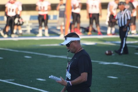 Head coach Dean Grosfeld, walking the sideline during the scrimmage. Grosfeld took the field for his first performance.