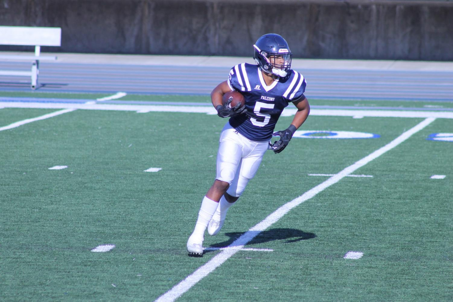 Freshman wide receiver no. 5, C.J. Parks running up the field. Parks is on his first year for the Falcons.