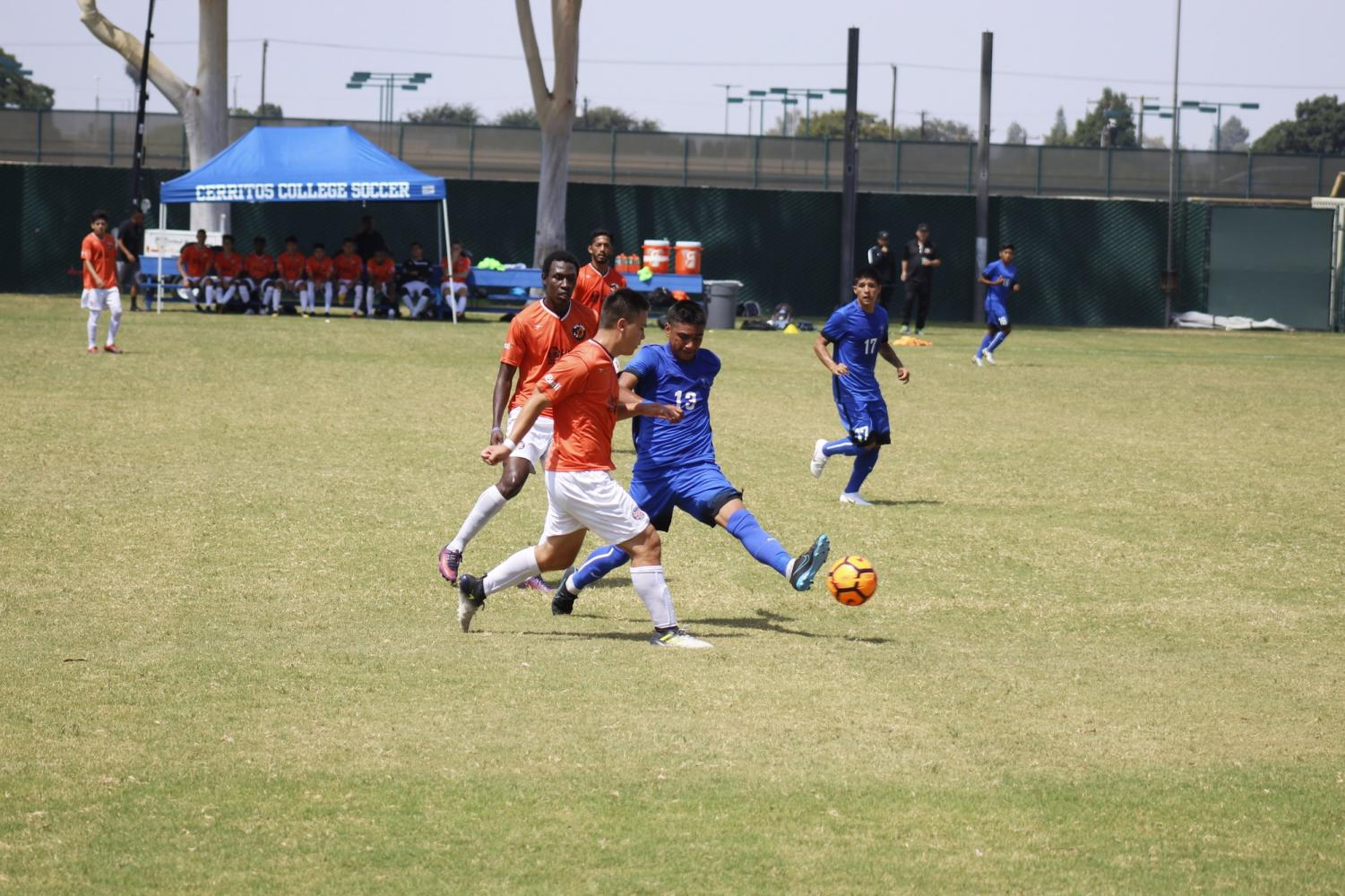 Sophomore forward No. 13, Christian Perez fighting for the ball during the first game of the day against the L.A. Wolves. Perez also played against the 2008 State Champion Alumni during the second half.
