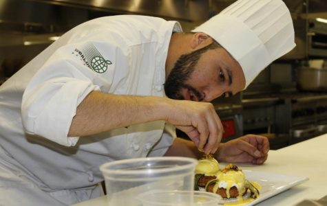 Philip Herrera topping off the finished product of Southwest eggs benedict.