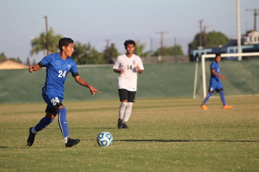 Sophomore+midfielder+No.+24+Carlos+Perez+calling+for+a+play+during+the+matchup+against+Long+Beach+City+College+at+Cerritos+College+on+Oct.+9%2C+2018.