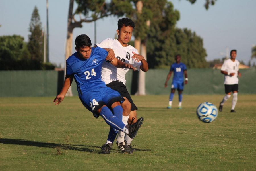 Freshman midfielder No. 24 Carlos Perez crossing in the ball past the defender against Long Beach City College at Cerritos College ending in a tie on Oct. 9.