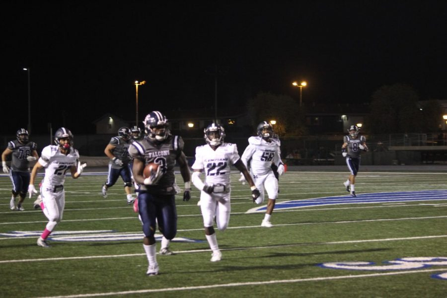 Sophomore running back No. 3 Rhamondre Stevenson breaking the defense and running the ball in for a touchdown. Stevenson ran for 270 yards in the game against San Diego Mesa College at Cerritos College on Oct. 20, 2018.