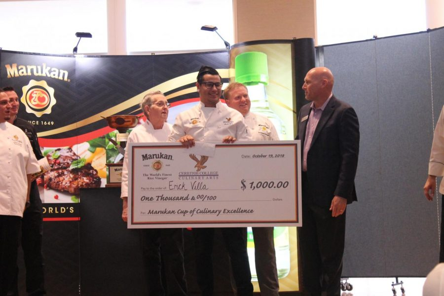 An excited Erick Villa places in first place at the Marukan Cup of Culinary Arts of Excellence competition. The competition was held on Oct. 19.