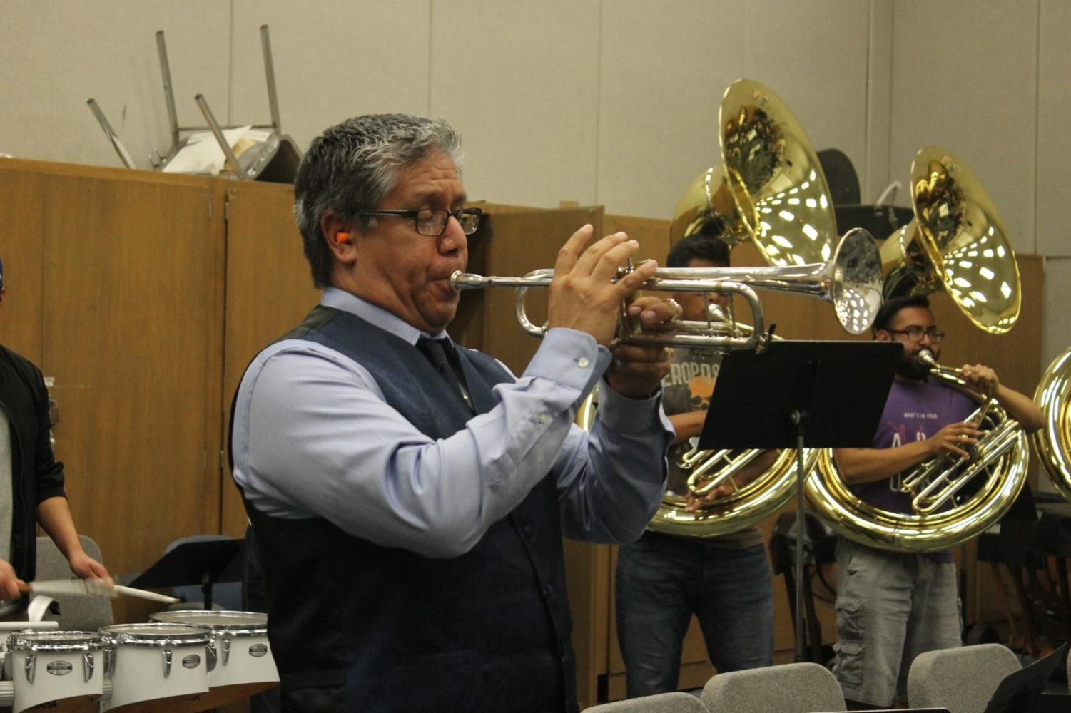 Dr. David Betancourt plays with the Pep Band during rehearsal