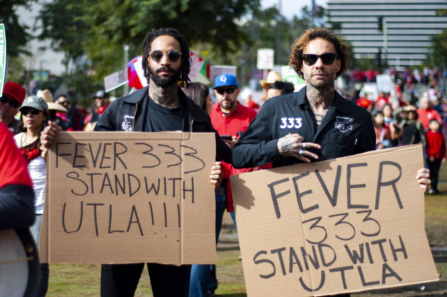 The Fever33 celebrate the drop of their first album, Strength in Numb33rs, by attending the DTLA teachers march on Friday, January 18.