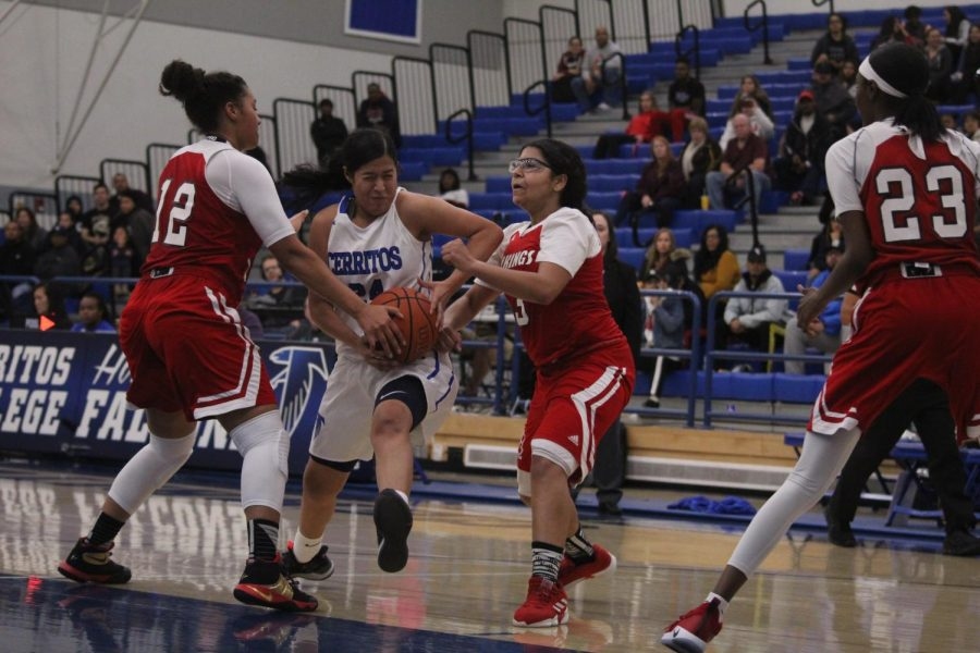 Sophomore guard No. 24 Serena Rendon fighting through the contact to get to the basket. Rendon finished the game with 17 points and seven rebounds in the game at Cerritos College against Long Beach City College on Feb. 8, 2019.