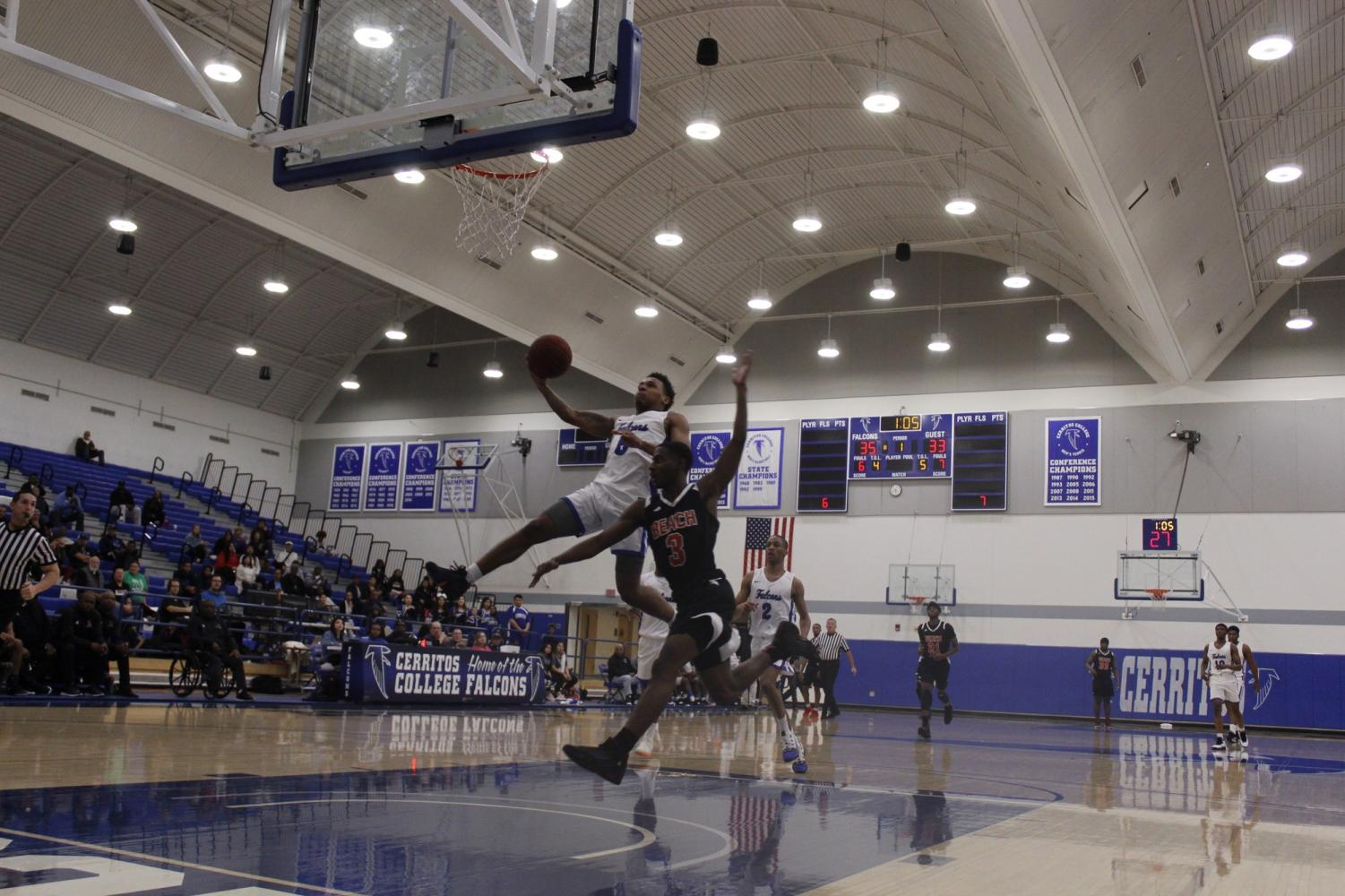 Sophomore guard No. 5 Tawon Elston jumped past the Long Beach City College defender to extend the lead in the first half. Elston finished with 23 points against Long Beach City College at Cerritos College on Feb. 8, 2019. Photo credit: Carlos Ruiz