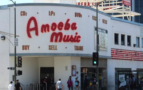 The neon marquee outside of Amoeba serves as a beacon for the ecosystem that is the Sunset Strip. Photo credit: Michael Reza