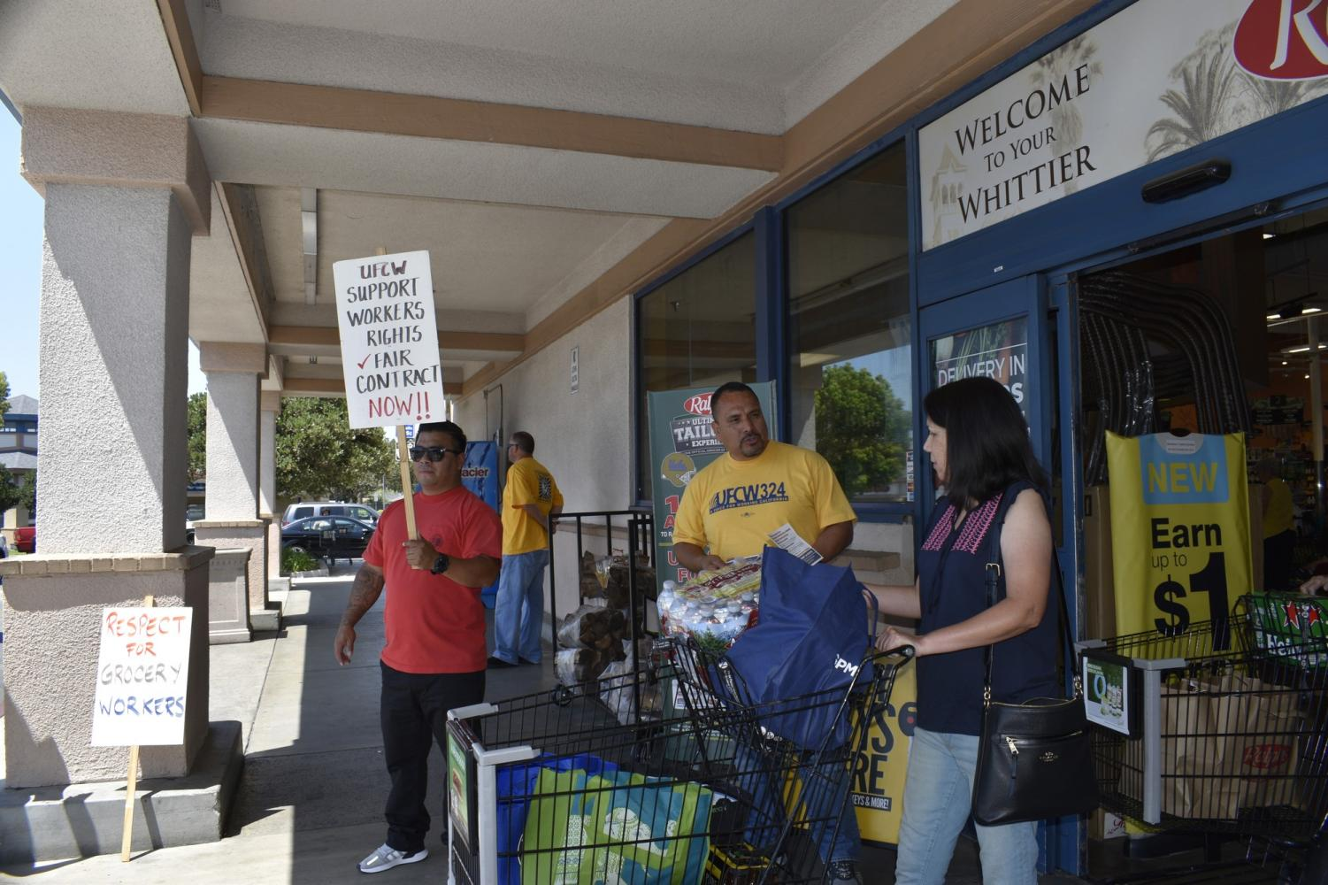 UFCW 324 members, and grocery store workers,  talk to customers at Ralphs Grocery Store about a possible strike.