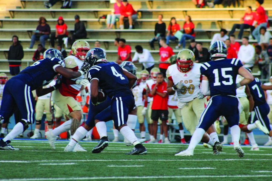 Carl Odom, runs the ball for a first touchdown during the game against College of the Desert. Falcons won the game 50-7.