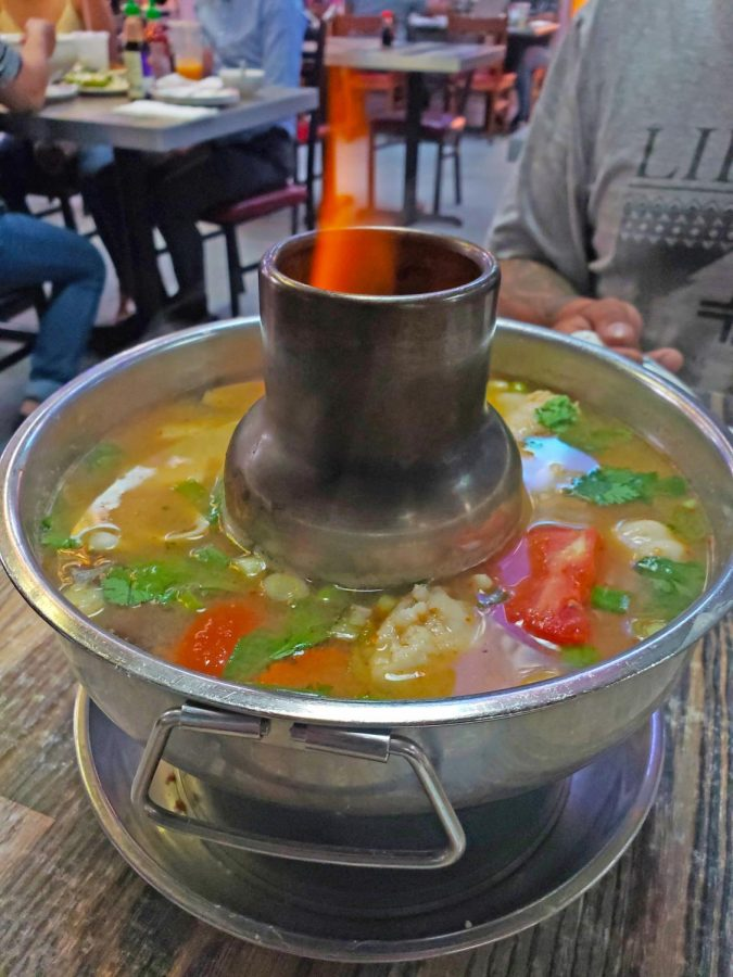 Jade Siams provides three levels of heat for their Po Tak Soup which is served in a silver shabbu pot.