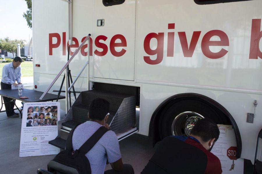 Two Cerritos College Students waiting for their name to be called to donate blood, inside the American Red Cross bloodmobile September 10, 2019. Photo credit: Jazmin Aguayo