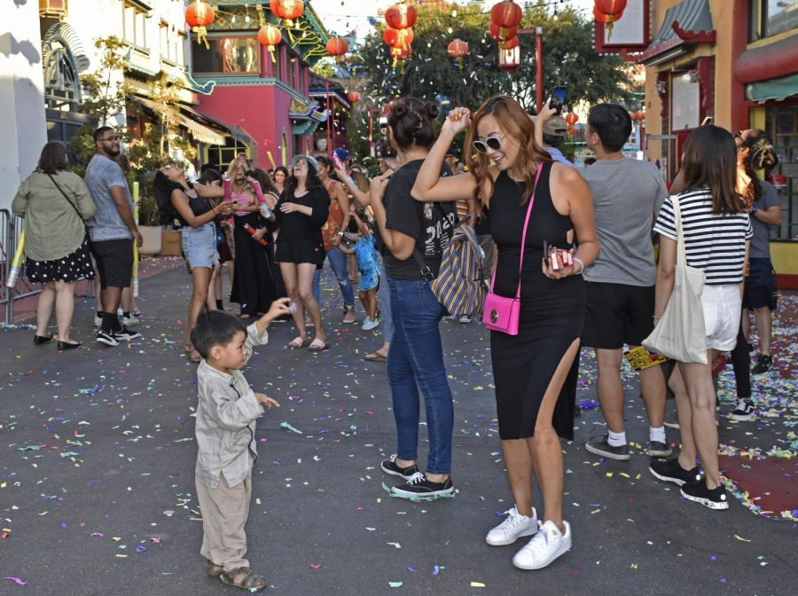 Connie Voung tossing poppers.  LA Chinatown Mid-Autumn Moon Festival on Sept. 15, 2019.