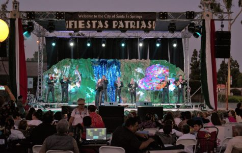 As Fiesta Patrias opens its doors to the public, a mariachi band performs their songs.