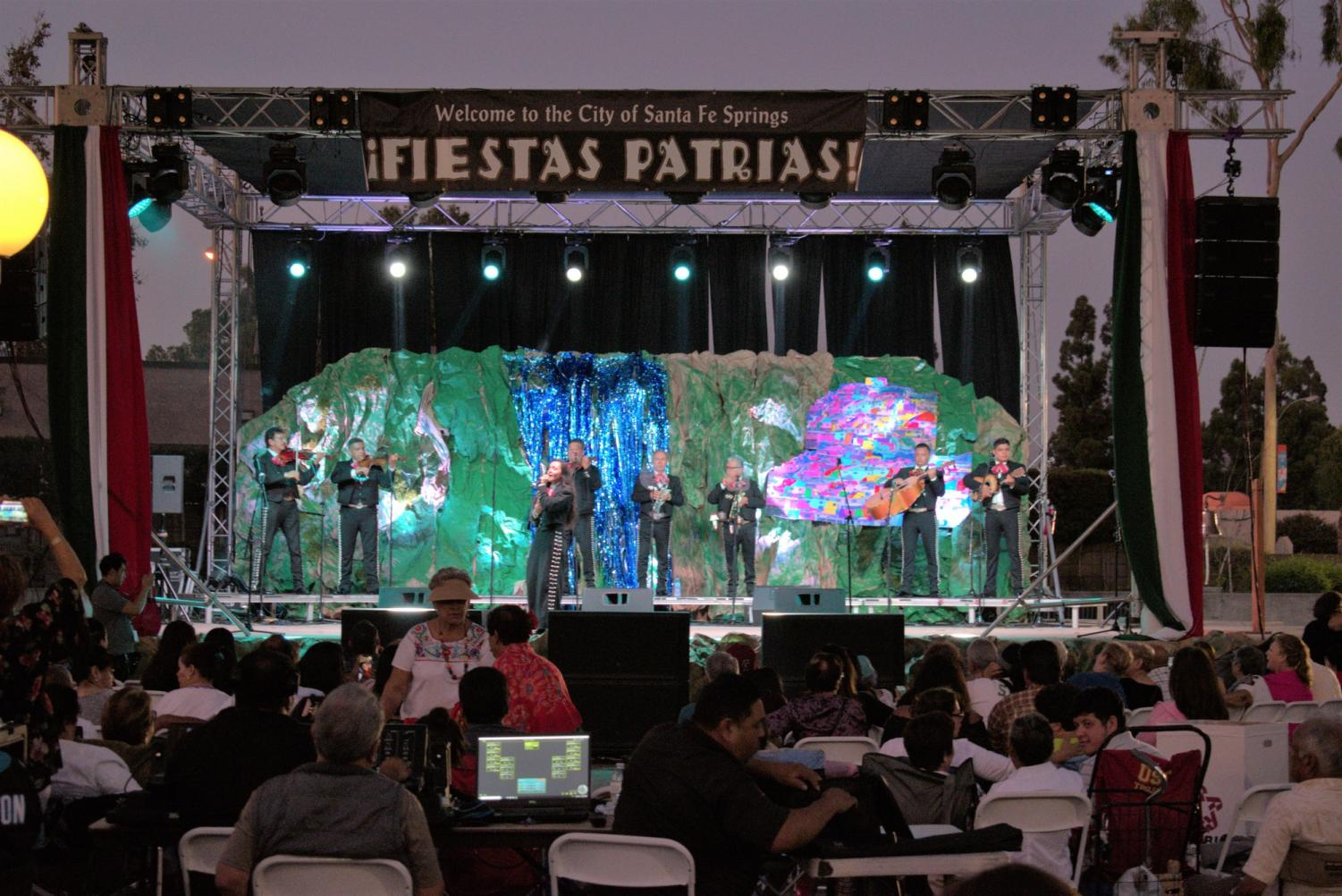 As+Fiesta+Patrias+opens+its+doors+to+the+public%2C+a+mariachi+band+performs+their+songs.+