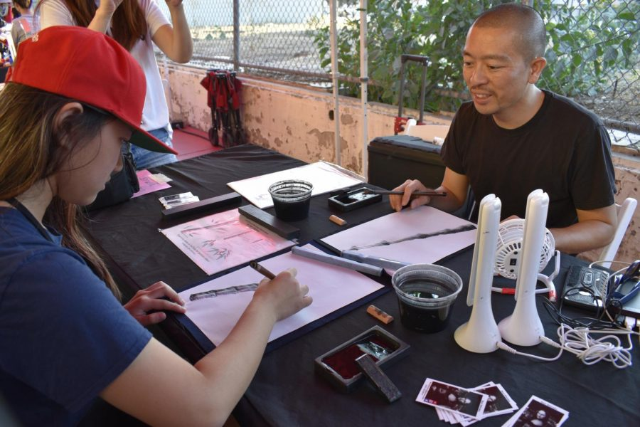Nori Shirasu is teaching moon festival attendees how to draw bamboo calligraphy art.  LA Chinatown Mid-Autumn Moon Festival on Sept. 15, 2019.