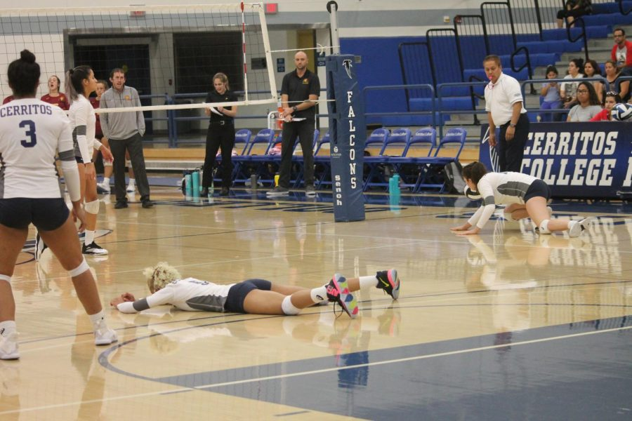 Jackie Dixon, Freshman outside hitter No. 5, lays on the floor as she attempted to hit the ball but landed on their side of the court resulting in no point.