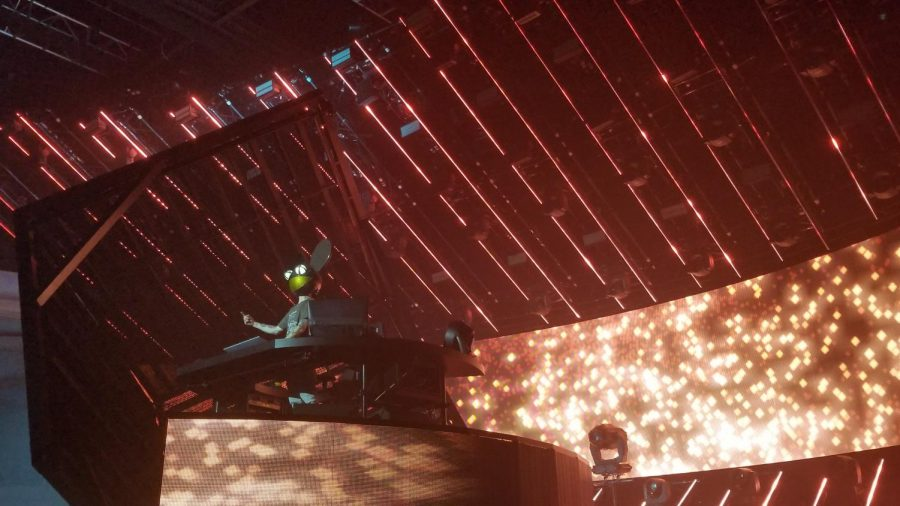 As his Cubev3 slowly rotates, Deadmau5 finally shows his 'face' embracing the crowd. Concert go-ers are relieved that they finally get to see their favorite DJ. Taken Sept 29, 2019.