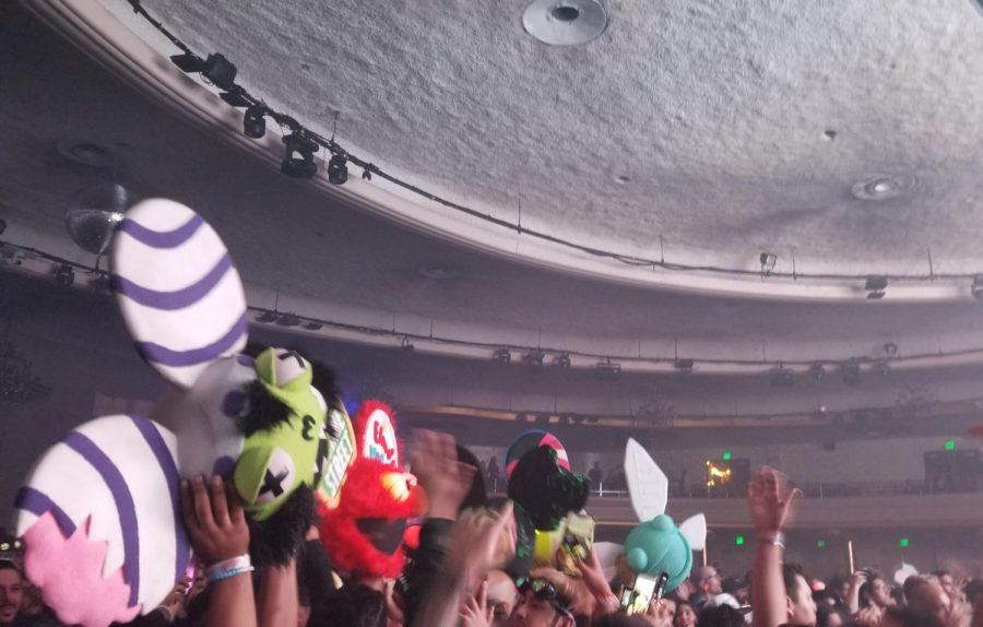 As Deadmau5 performs, the bright lights light up the venue. Fans with their homemade Deamau5 masks dance along as they reach to the front.