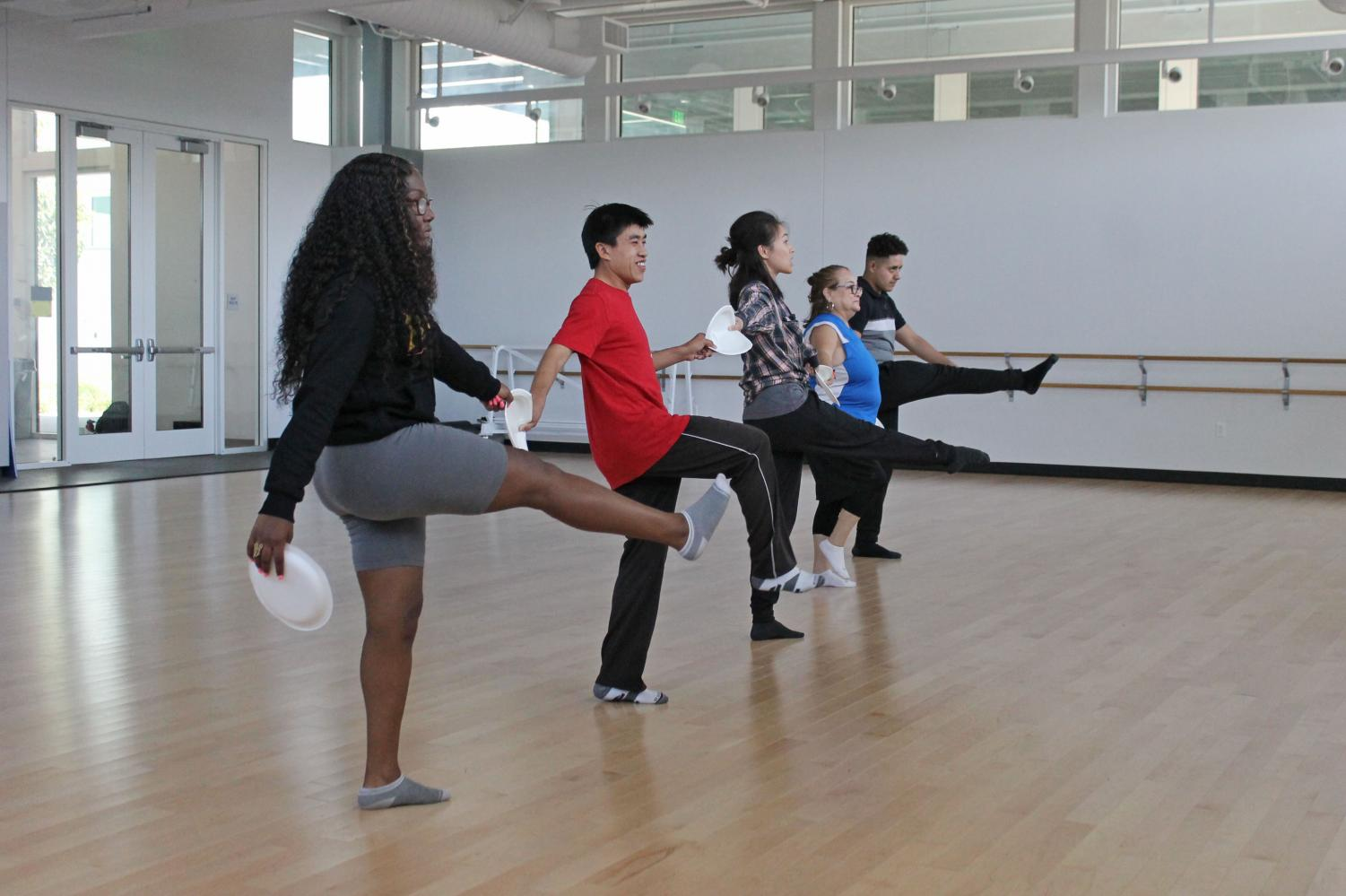 Adaptive Dance: students and instructor dance during the first-thought adaptive PE course at Cerritos College by Beatrice Horner, a part-time adaptive dance professor. she is hands-on and teaches students proper form and rotation to protect their knees. Photo credit: Derrick Coleman