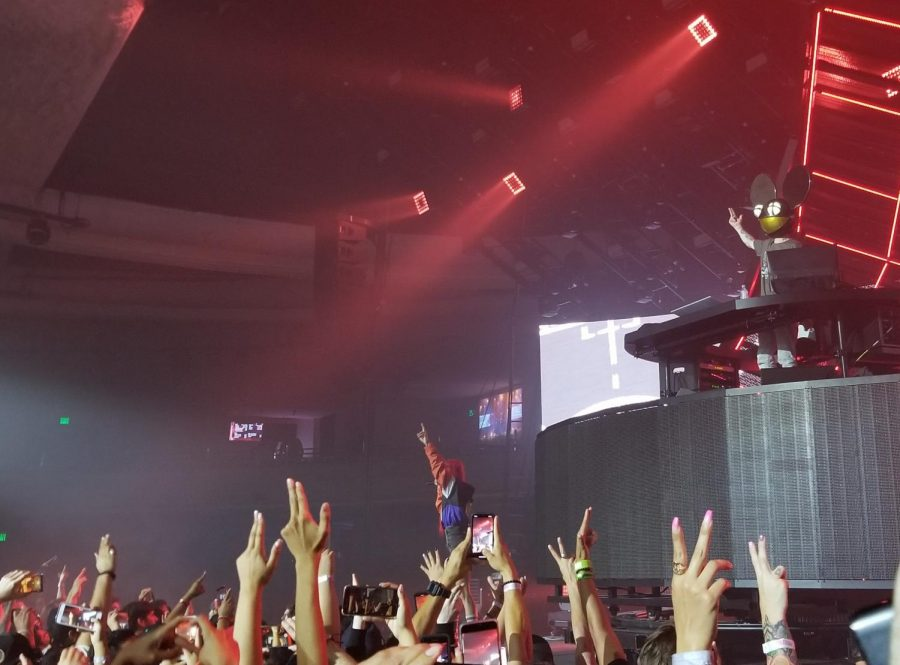 Towards the end of the show, Lights, Canadian singer and songwriter, joins Deadmau5 to perform Raise Your Weapon. Fans raise their arms and dance along to their music.
