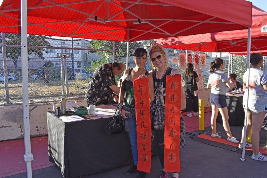 Wanda Ramos and Samantha Cheyne display their handwritten calligraphy banners representing the year and moon. LA Chinatown Mid-Autumn Moon Festival on Sept. 15, 2019.