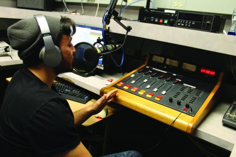 Joshua Negrete, practices his voice recording in the main studio at the WPMD broadcasting studios. Negrete is majoring in both music and business. Photo was taken on Oct. 22, 2019.