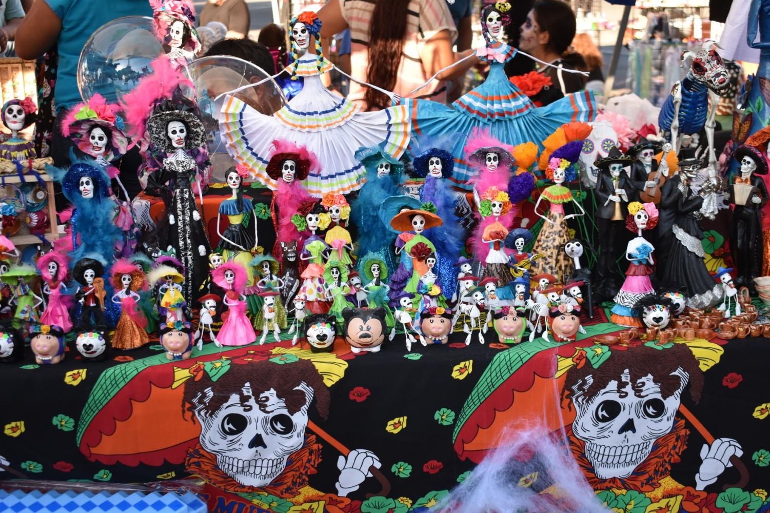 Display of Day of the Dead Art being sold. The bright colors used are common during the Day of the Dead celebration.