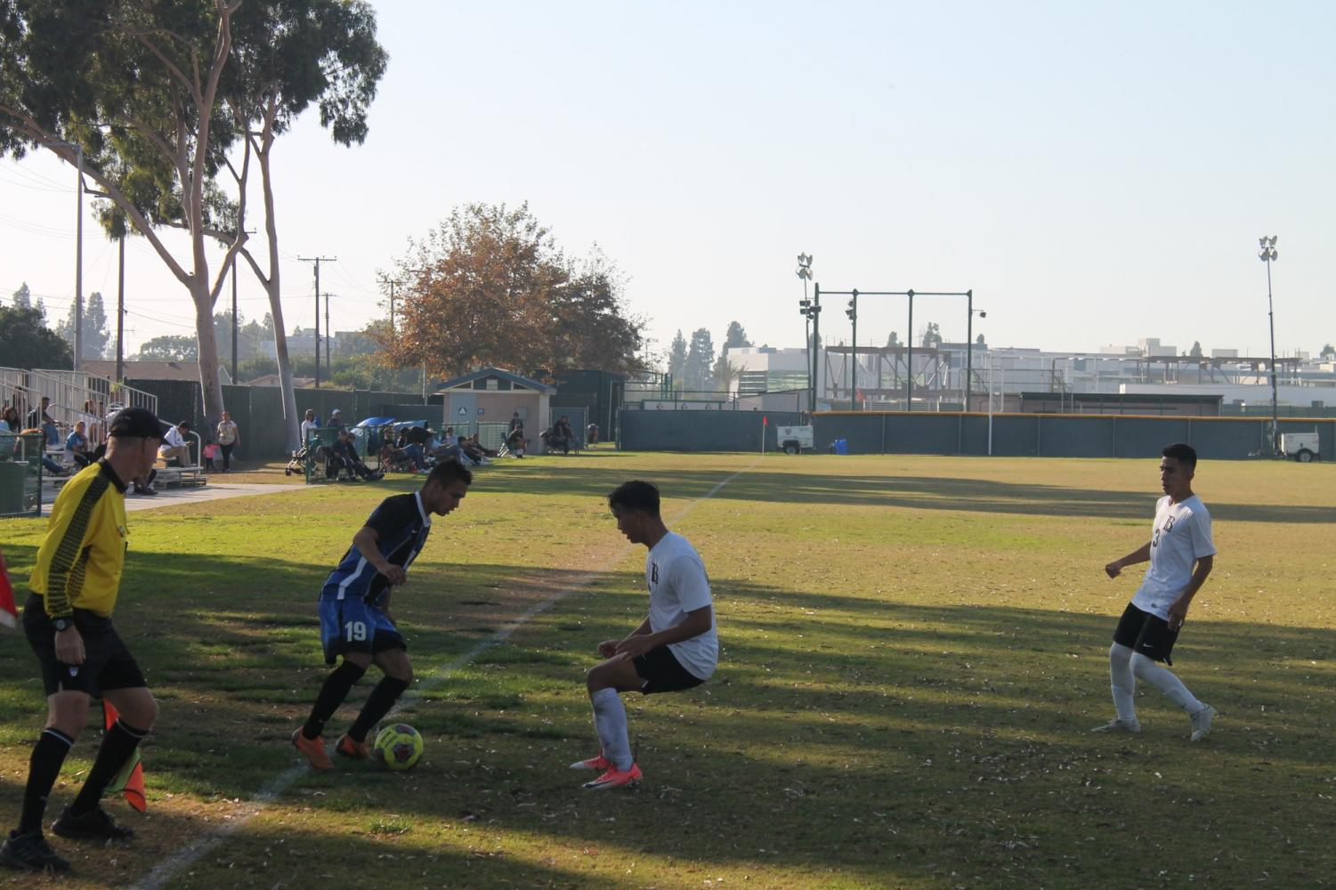 Freshman midfielder No. 19 Bryan Perez aiming for a shot-on-goal for Cerritos. The Falcons had 14 shots-on-goal however scored only two goals to beat Long Beach City College 2-0 on Tuesday, Nov. 5.