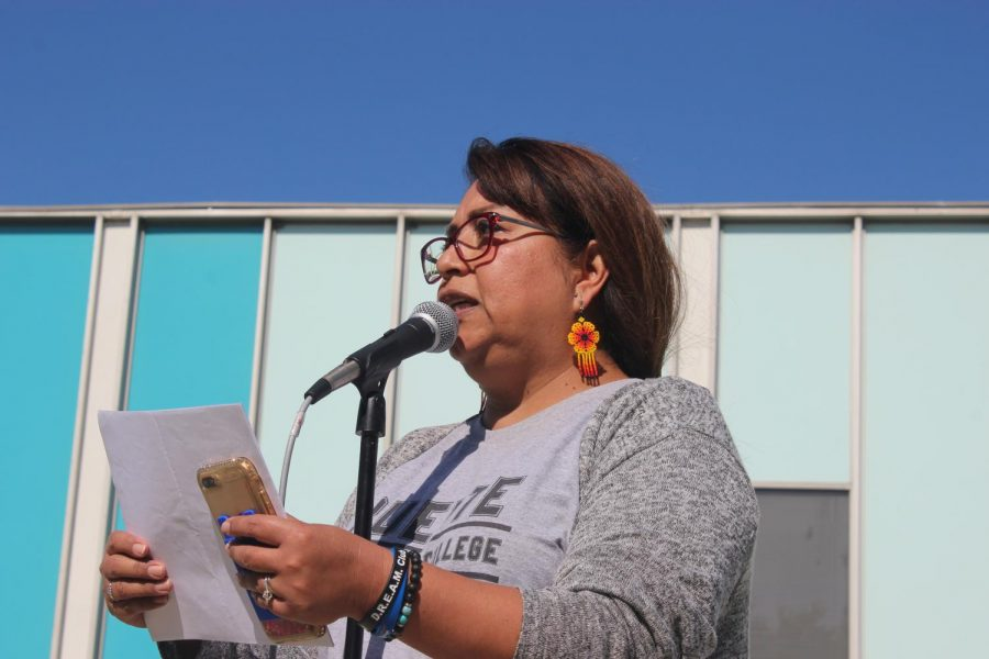 Rosa Carrillo, campus counselor for undocumented students at Cerritos College and Dream Club advisor reads poem
