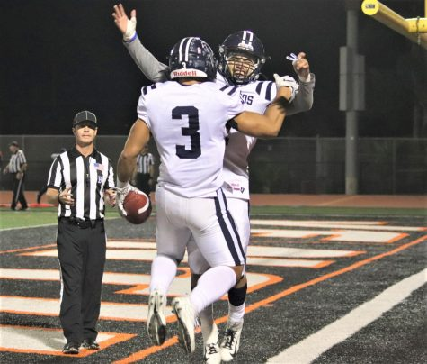 Hinckley Ropati, No. 3, celebrates his third rushing touchdown with teammate Jovohn Hardy No.6  late in the fourth. The Falcons defeated the Ventura Pirates on Nov. 23, 2019. Photo credit: Anthony Saldana