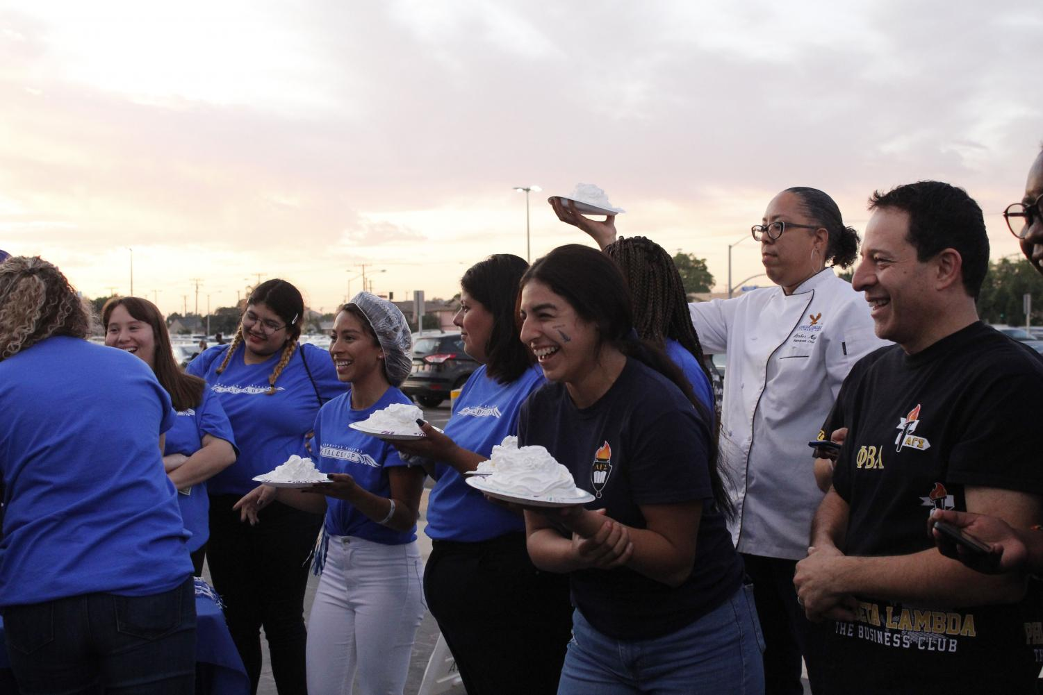 Faculty and staff members anticipate their turn in covering President of Cerritos College Jose Fierro in whip cream, making the most out of the $100 donation. The pie-in-the-face event raised $1,018 total for personal care products on Nov. 2, 2019.
