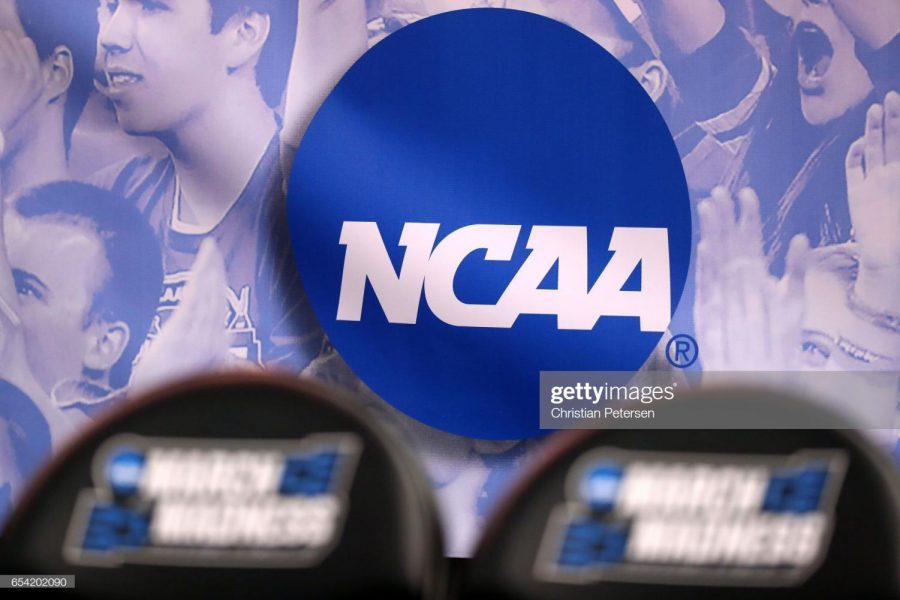 SALT LAKE CITY, UT - MARCH 16: The NCAA logo is seen in the second half of the game between the Northwestern Wildcats and the Vanderbilt Commodores during the first round of the 2017 NCAA Men's Basketball Tournament at Vivint Smart Home Arena on March 16, 2017 in Salt Lake City, Utah