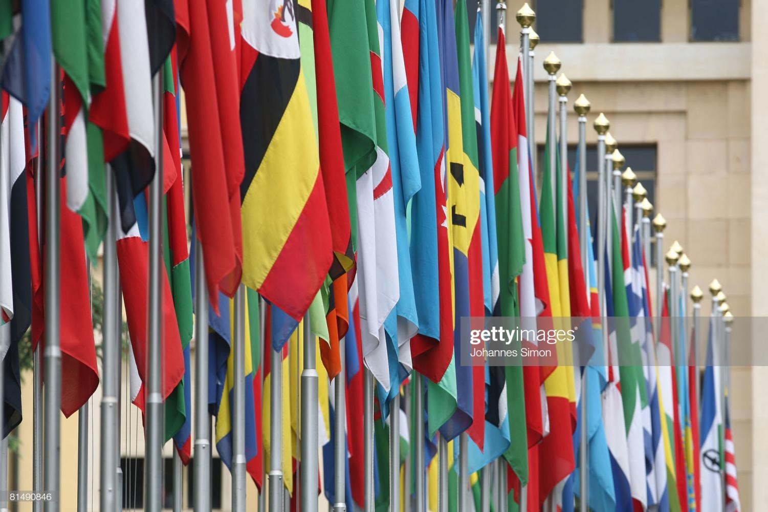 GENEVA - JUNE 08: Numerous national flags are seen in front of the United Nations Office (UNOG) on June 8, 2008 in Geneva, Switzerland. Housed at the Palais des Nations, the United Nations Office at Geneva serves as the representative office of the Secretary-General at Geneva. A focal point for multilateral diplomacy, UNOG services more than 8,000 meetings every year, making it one of the busiest conference centres in the world. With more than 1,600 staff, it is the biggest duty stations outside of United Nations headquarters in New York