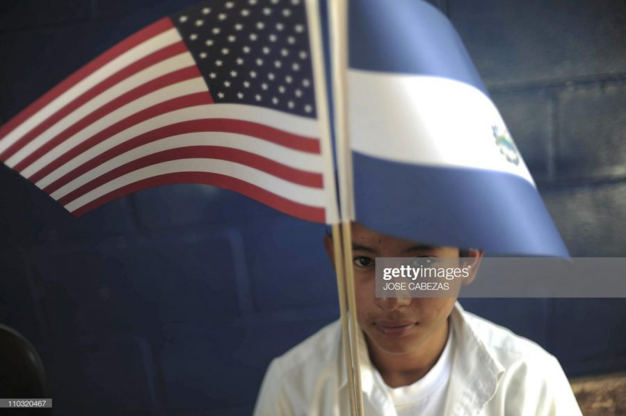 Schoolboy Jorge Sermeno hold a US and a Salvadorean flags during the preparations for President Barack Obama's visit next week, in the town of Comasagua, 30 km southwest of San Salvador on March 17, 2011. A hundred students of the United States of America school will receive president Obama during his visit to El Salvador next March 22