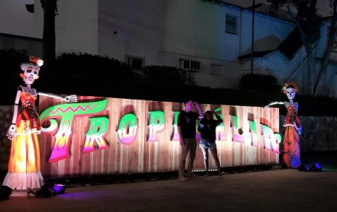 As the night comes to an end, attendees take their last picture by the Tropicalia sign. The sign consisted of Day of the Dead figures and bright lights.