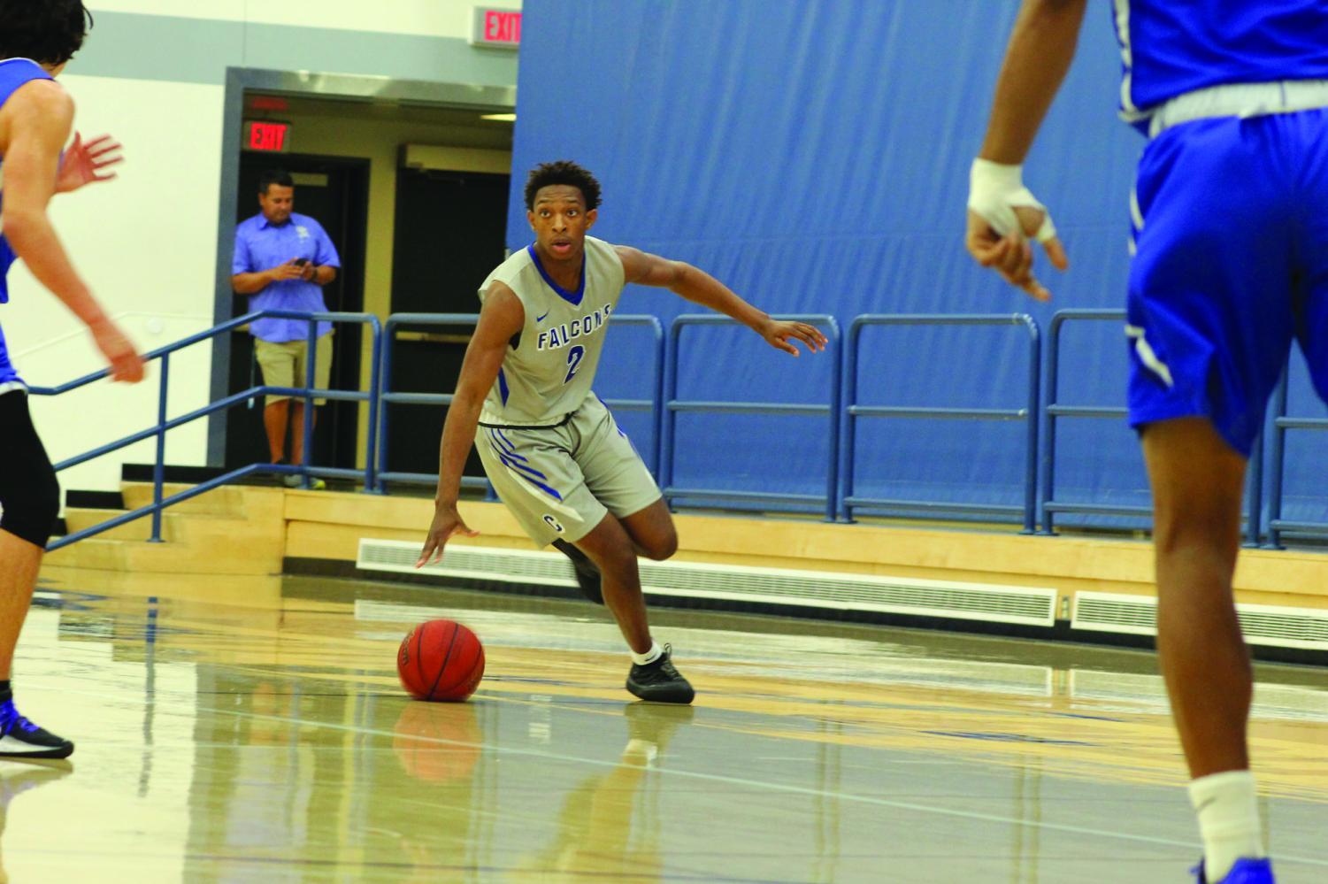Down the Court: sophomore point guard Joshua Belvin dribbles the ball to the basket against Santa Monica College. The Falcons lost 71-61 on Nov. 22, 2019