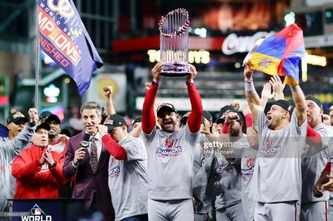 HOUSTON, TEXAS - OCTOBER 30: Manager Dave Martinez #4 of the Washington Nationals hoists the Commissioners Trophy after defeating the Houston Astros 6-2 in Game Seven to win the 2019 World Series in Game Seven of the 2019 World Series at Minute Maid Park on October 30, 2019 in Houston, Texas