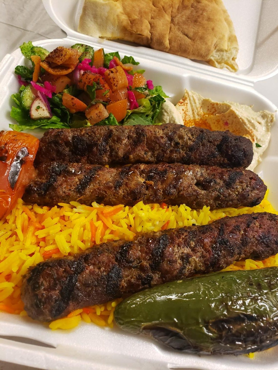 Beef Kafta plate with a delicious house salad and yellow jasmine rice to tie-in everything together.