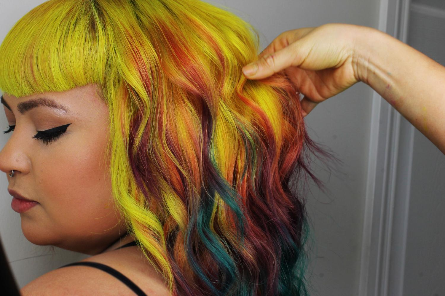Grajeda makes sure that every color is captured when her client models their new do. Photo credit: Rebecca Aguila