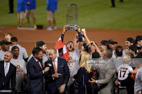 LOS ANGELES, CA - NOVEMBER 01: Carlos Correa #1 of the Houston Astros hoists the Commissioner