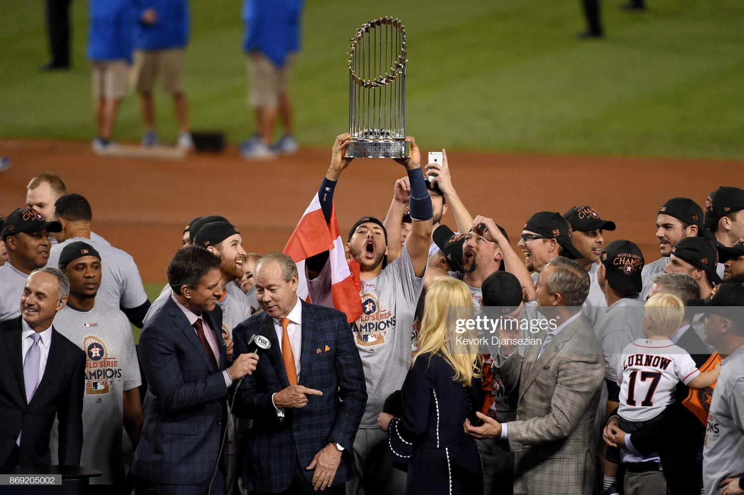 LOS ANGELES, CA - NOVEMBER 01: Carlos Correa #1 of the Houston Astros hoists the Commissioner's Trophy after defeating the Los Angeles Dodgers 5-1 in game seven to win the 2017 World Series at Dodger Stadium on November 1, 2017 in Los Angeles, California.