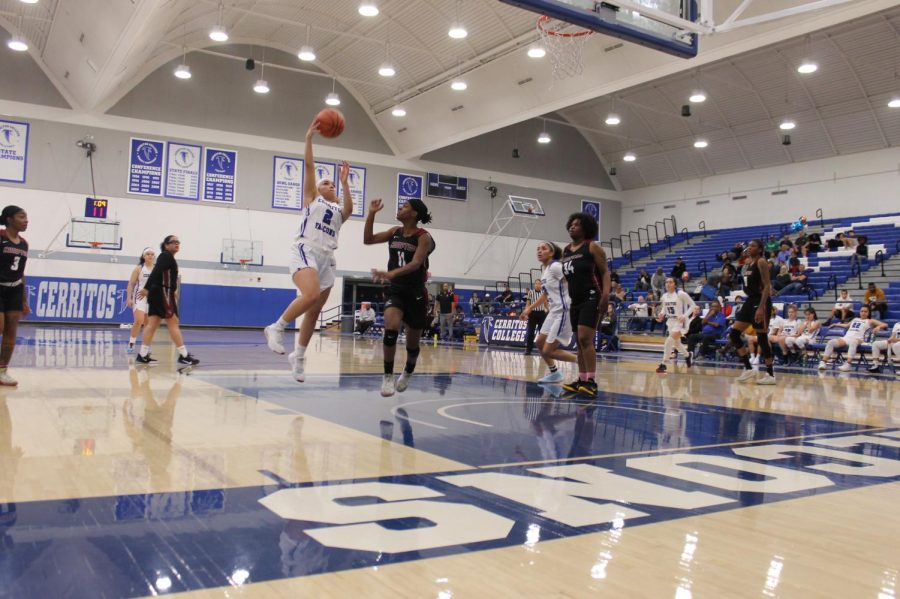 The women's basketball team securesthe win against Compton College. Guard Mariah Lora goes for a hook shot against the team on February 19, 2020. Photo credit: Derrick Coleman