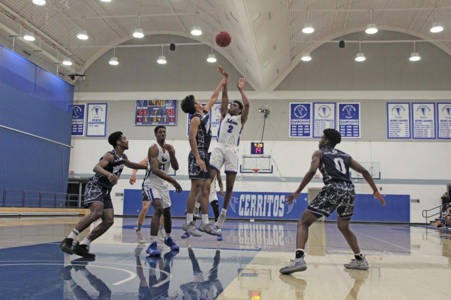 Freshman+point+guard+No.2+Joshua+Belvin+hits+a+step+back+jumper+against+a+an+El+Camino+defender.+Cerritos+played+El+Camino+on+Friday+Feb.14.+Photo+credit%3A+Keanu+Ruffo